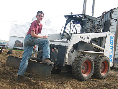 Daniel enjoyed learning how to drive the Bobcat, too