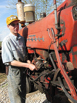 Daniel tuning up Uncle Russ' Farmall 400