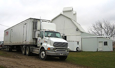 The UNFI truck comes to pick up an order of our 7-grain flour and cereal for distribution around the midwest, Spring 2005.